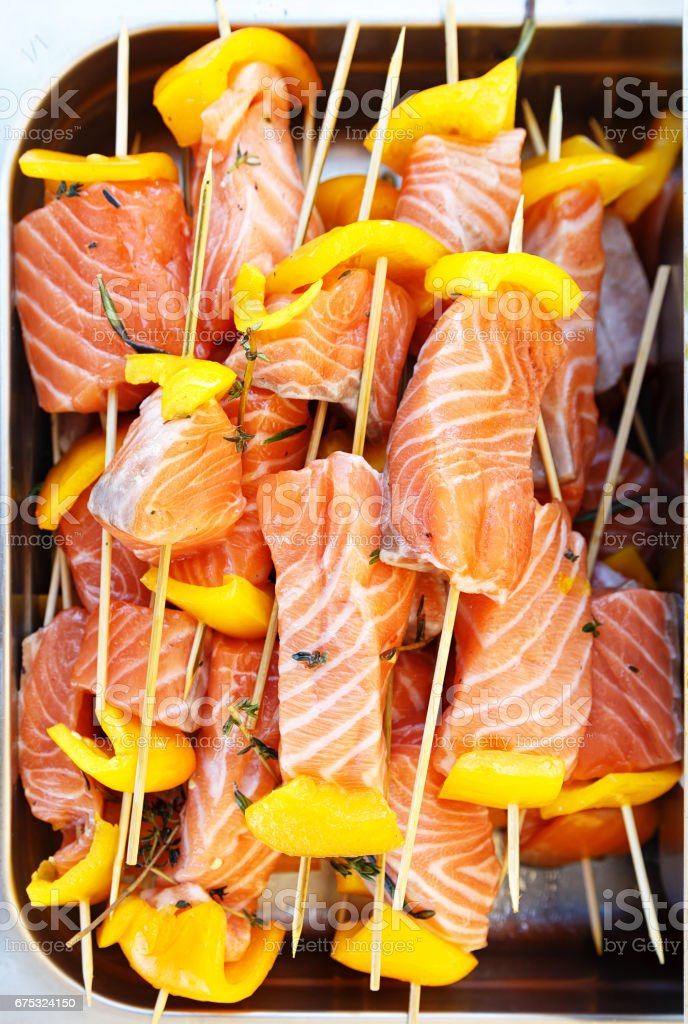 Shish kebab from raw salmon stock photo