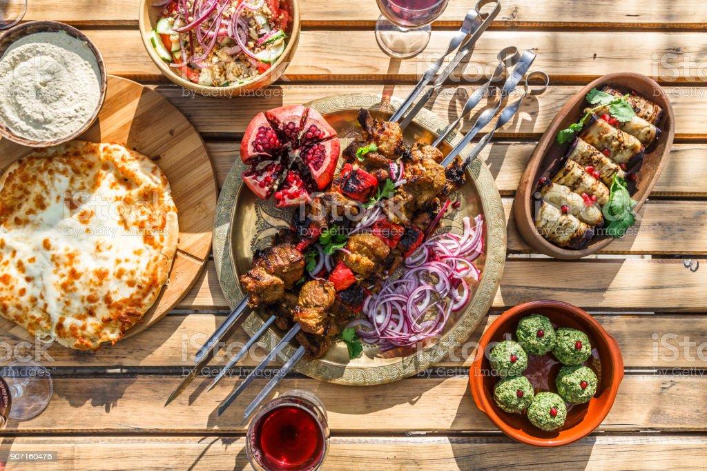 Shish kebab or shashlik, grilled meat skewers, traditional georgian dish, top view stock photo