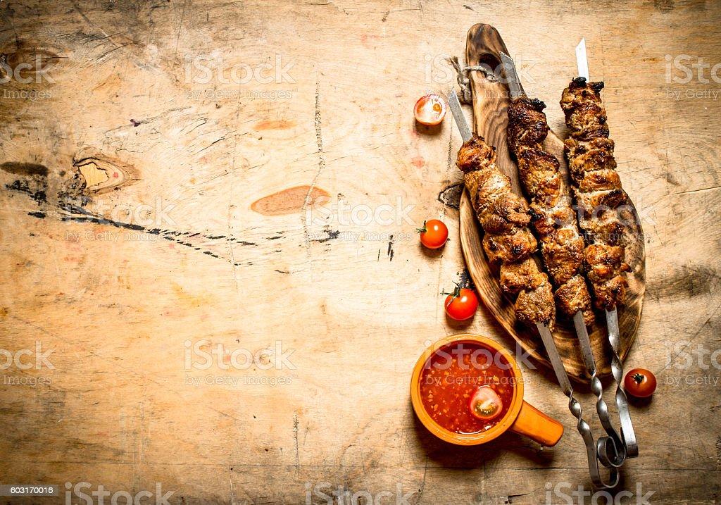 Shish kebab with tomato sauce. stock photo