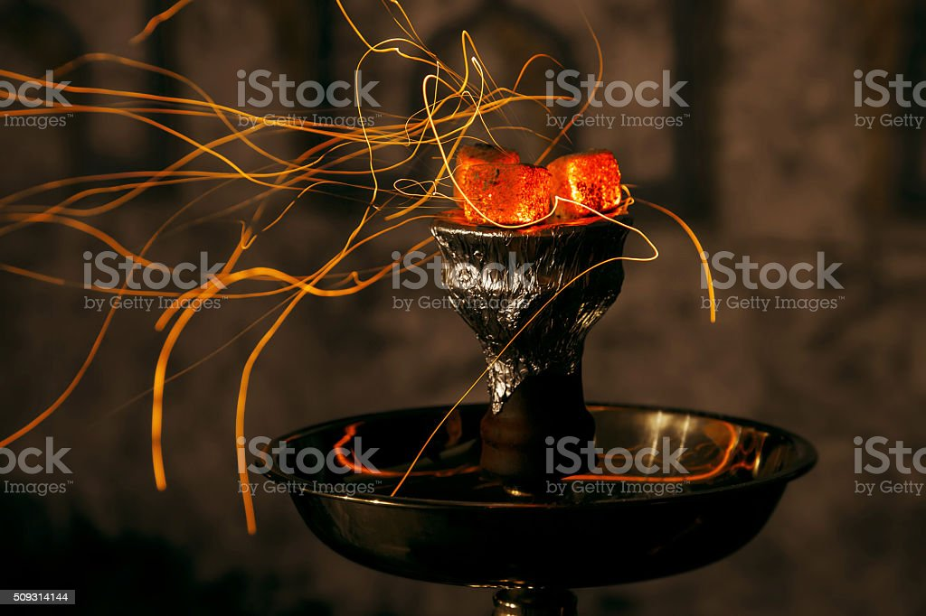 shisha hookah red hot coals. Sparks from breathe stock photo