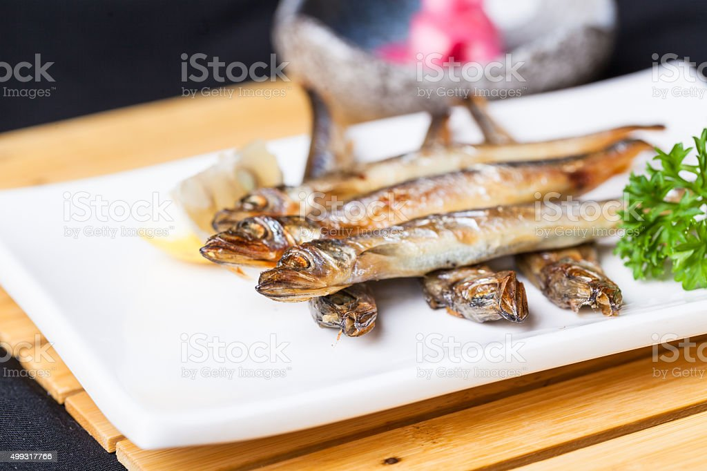 shishamo fried in dish stock photo