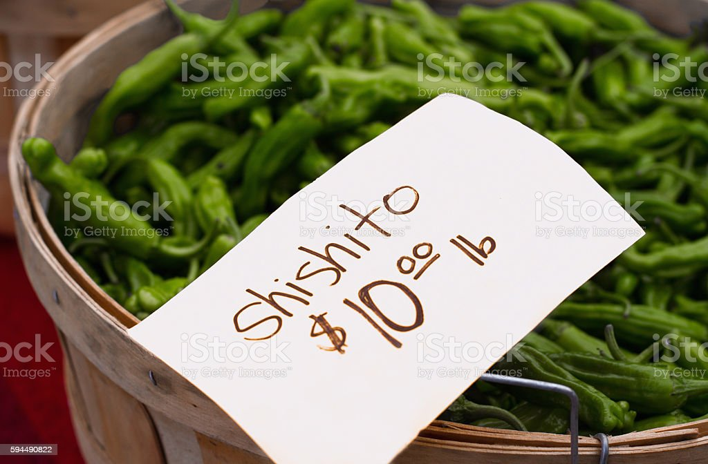 Shishito Peppers In Bushel Basket At Farmers Market With Labelprice