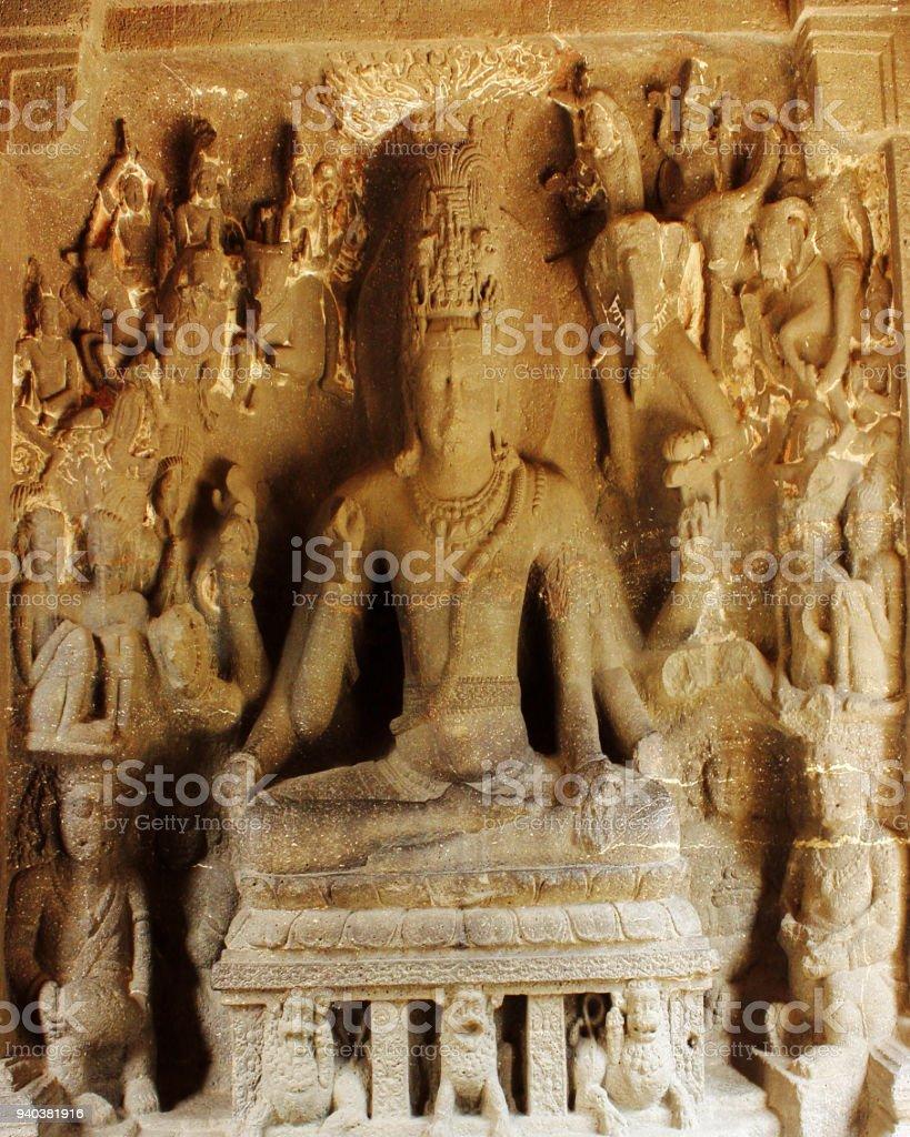 Shiva doing Yoga in Ellora Caves in India - 1000 CE old single rock cut Hindu Kailash temple stock photo