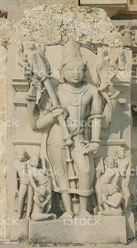 Shiva with Trishula(trident),detail of Khajuraho temple in India stock photo