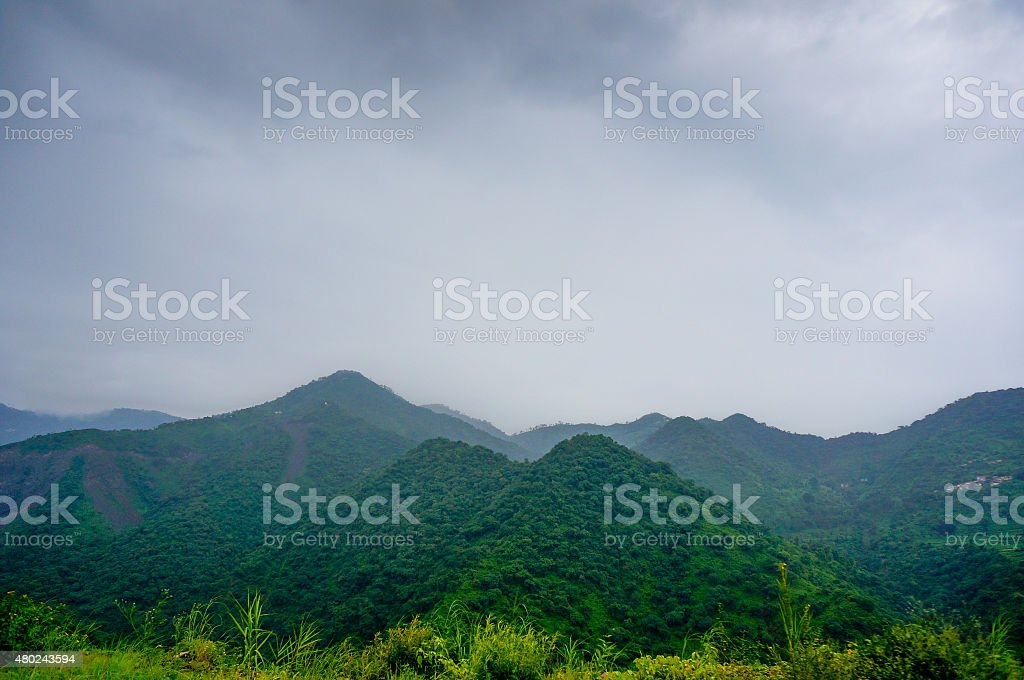 Shivalik hills with clouds and fog stock photo
