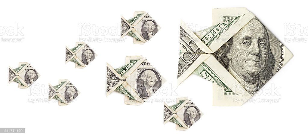 Shoal of dollar origami fish isolated stock photo