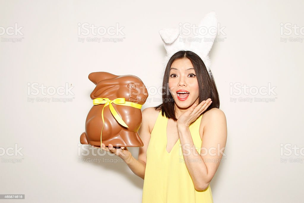 Shock Easter bunny girl with Rabbit chocolate stock photo
