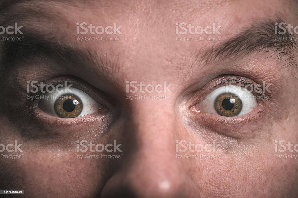 Shock. Surprise. Wide open eyes. Staring. stock photo