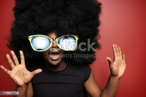 Color photo of a surprised young man with a huge afro.
