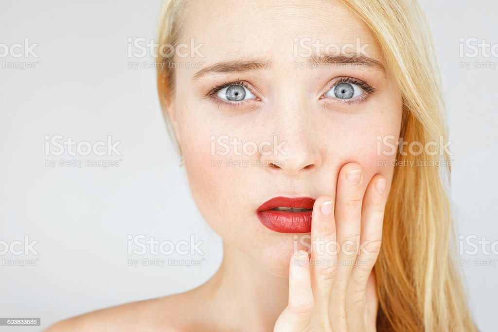 Shocked and amazed red-haired woman portrait stock photo