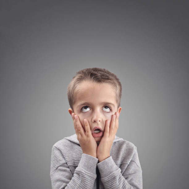 shocked and surprised child fed up, bored or showing despair - disappointment stock pictures, royalty-free photos & images