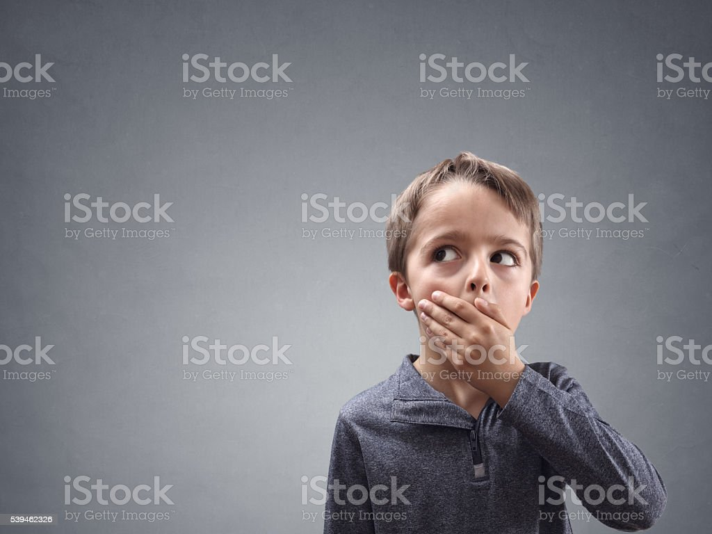 Shocked and surprised child looking into copy space stock photo