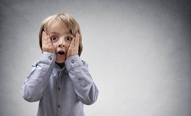 Shocked and surprised child stock photo