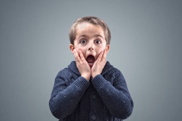 shocked and surprised child - fear stock photos and pictures