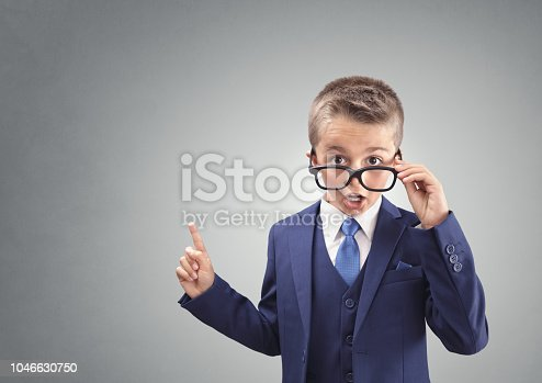 istock Shocked and surprised young confident executive businessman boy 1046630750