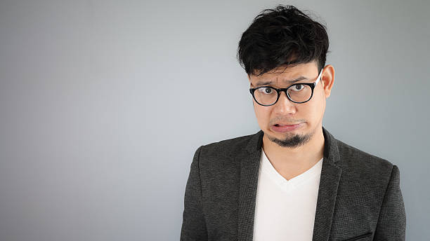shocked asian businessman with glasses. - omg stock photos and pictures