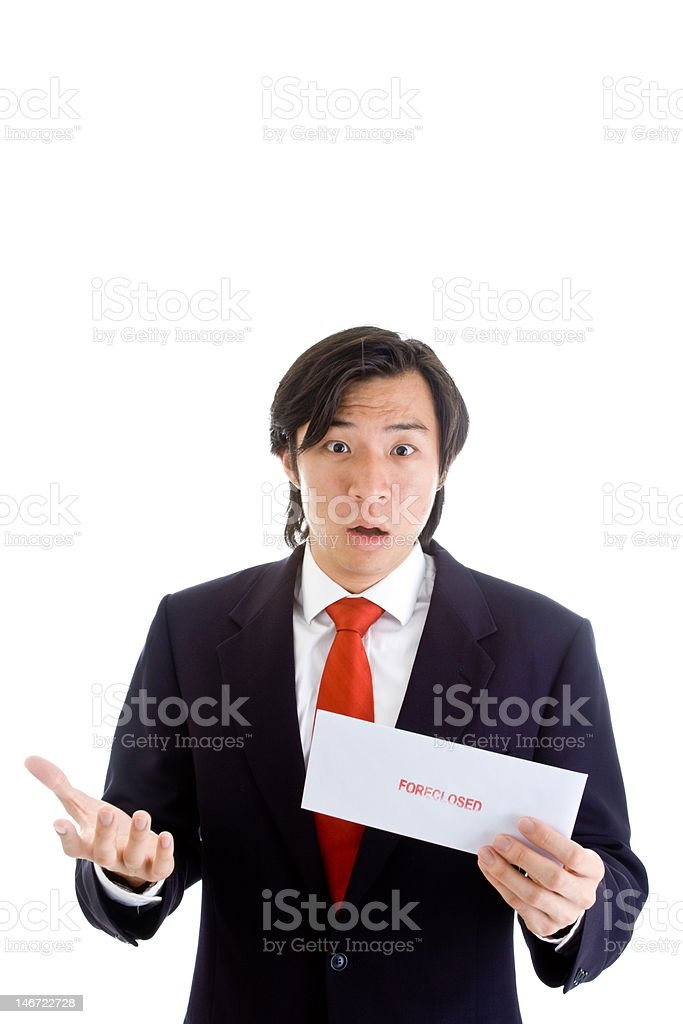 Shocked Asian Man Holding a Foreclosure Notice Envelope Isolated Background royalty-free stock photo