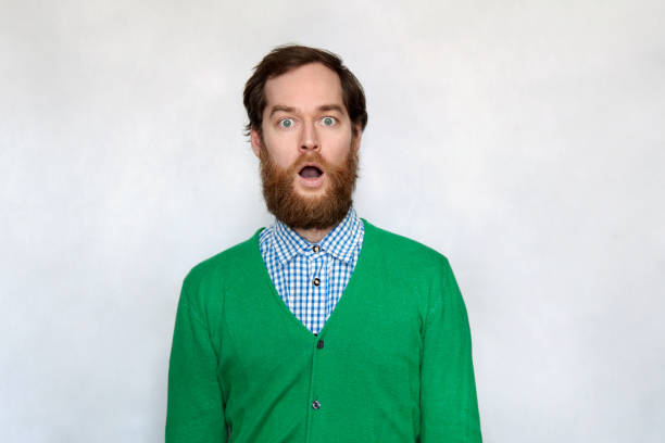 Shocked bearded man with open mouth stock photo