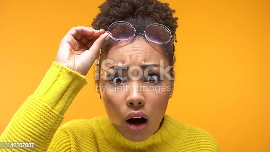 istock Shocked black female looking camera noticing first wrinkles, skin care, surprise 1142207637