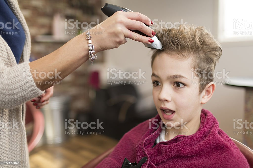 Shocked Boy Getting A Haircut Royalty Free Stock Photo