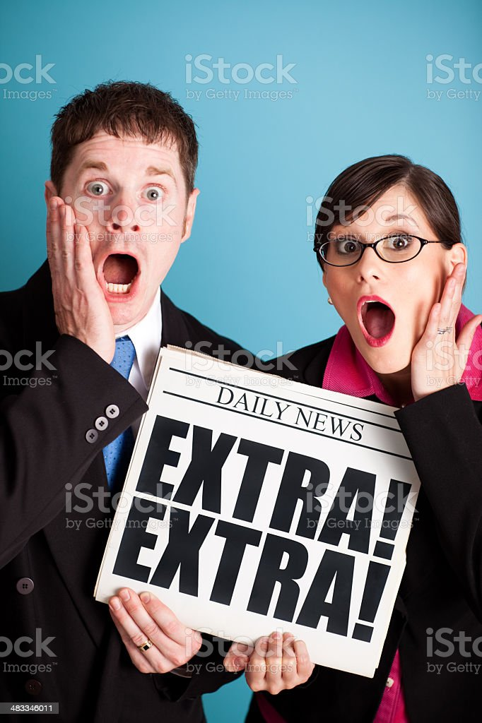 Shocked Business Man and Woman Holding Extra! Headline Newspaper royalty-free stock photo
