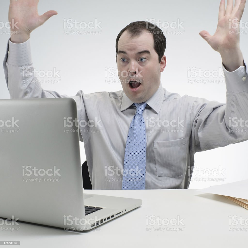 Shocked Business Man Seeing Good News On His Laptop royalty-free stock photo