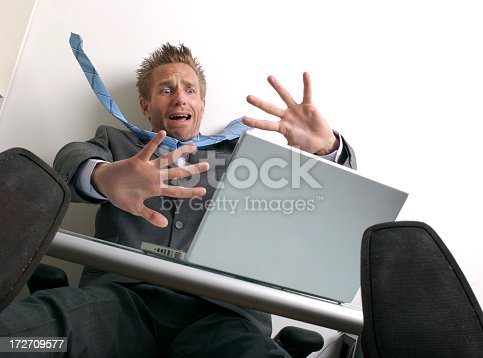 481644192 istock photo Shocked Businessman Freaking Out at Topsy-Turvy Desk Laptop 172709577