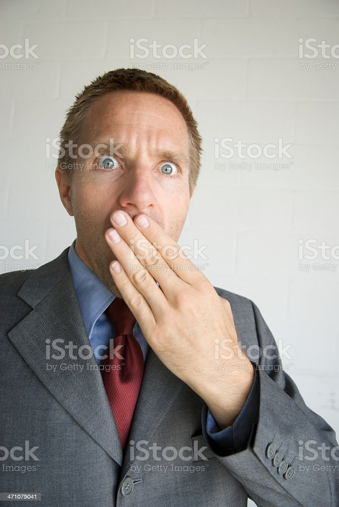 Shocked Businessman Holding Hand to Face in Surprise royalty-free stock photo