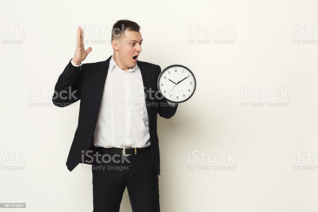 shocked businessman looking at clock stock photo more pictures of