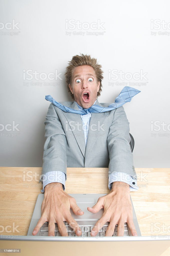 Shocked Businessman Office Worker Looking Surprised at His Laptop stock photo