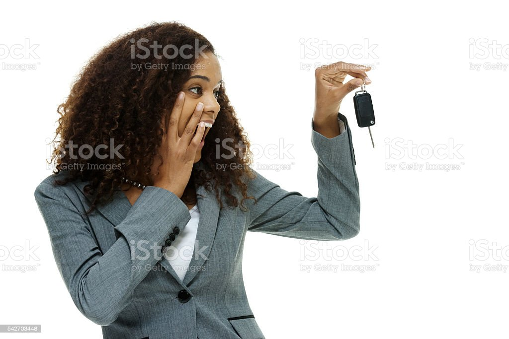 Shocked businesswoman looking at car key stock photo