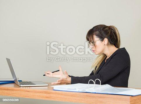 187928332istockphoto Shocked businesswoman 986556098