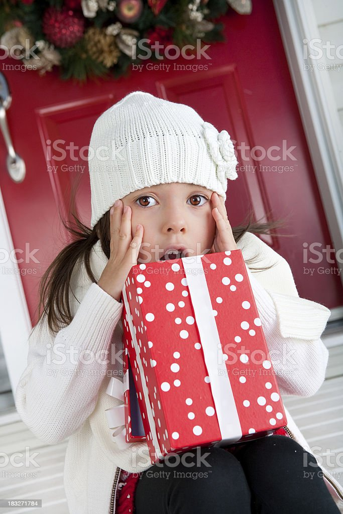 Shocked girl opening christmas present royalty-free stock photo