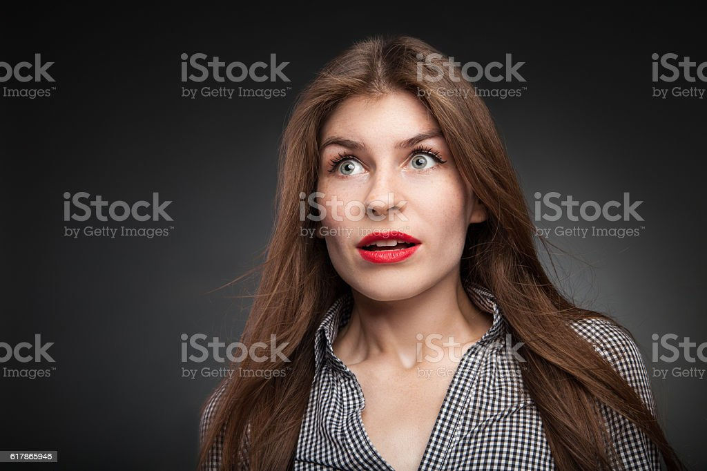 Shocked girl with wide opened eyes. stock photo
