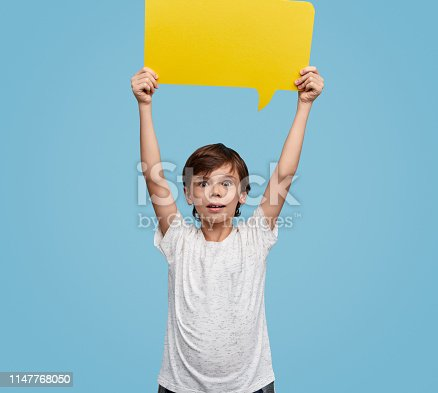 465462550istockphoto Shocked kid showing blank speech bubble 1147768050