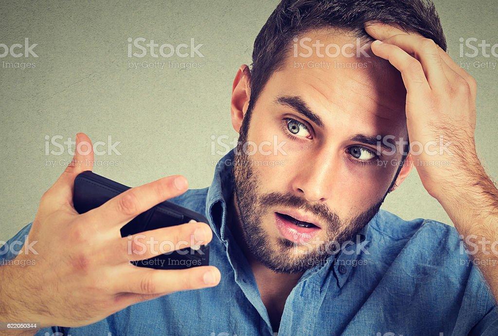 shocked man feeling head, surprised he is losing hair stock photo