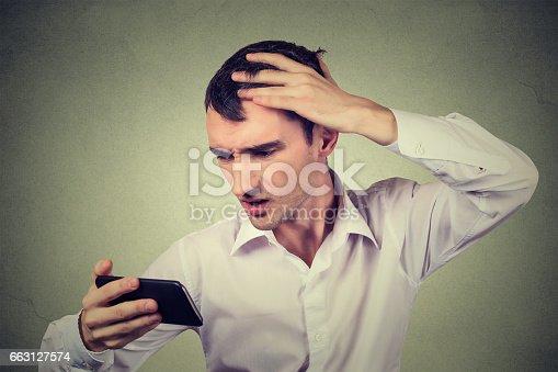 1130731761istockphoto shocked man feeling head, surprised he is losing hair 663127574