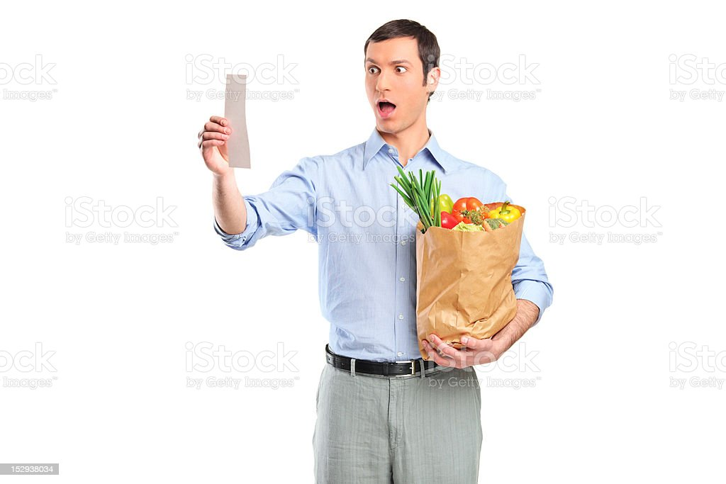 Shocked man looking at store receipt royalty-free stock photo
