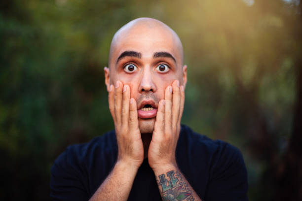 Shocked Man Shocked Man at the park. gasping stock pictures, royalty-free photos & images