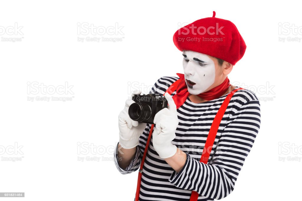 shocked mime taking photo with film camera isolated on white stock photo