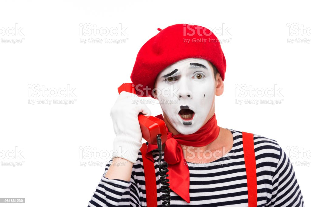 shocked mime talking by stationary telephone isolated on white stock photo
