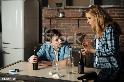 istock Shocked mother caught her son while drinking beer 683967196