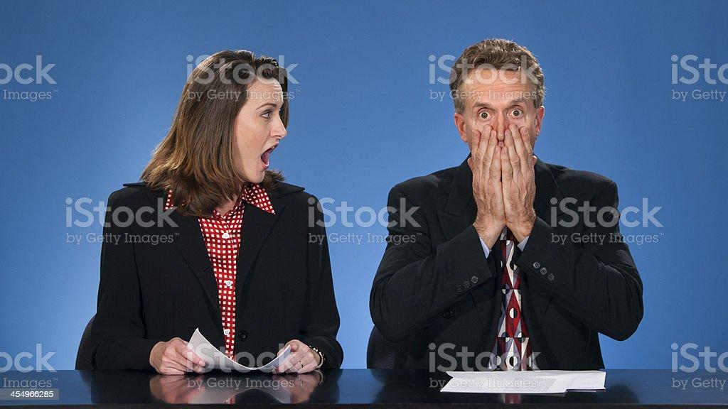 Shocked newcasters. stock photo