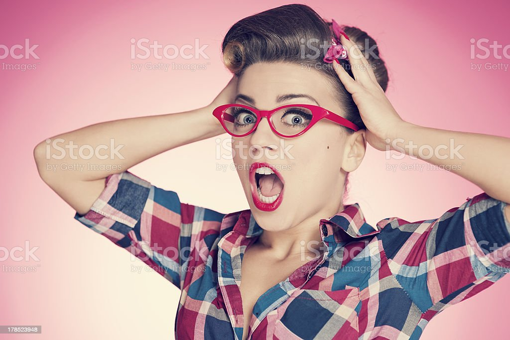 Shocked pin up girl stock photo