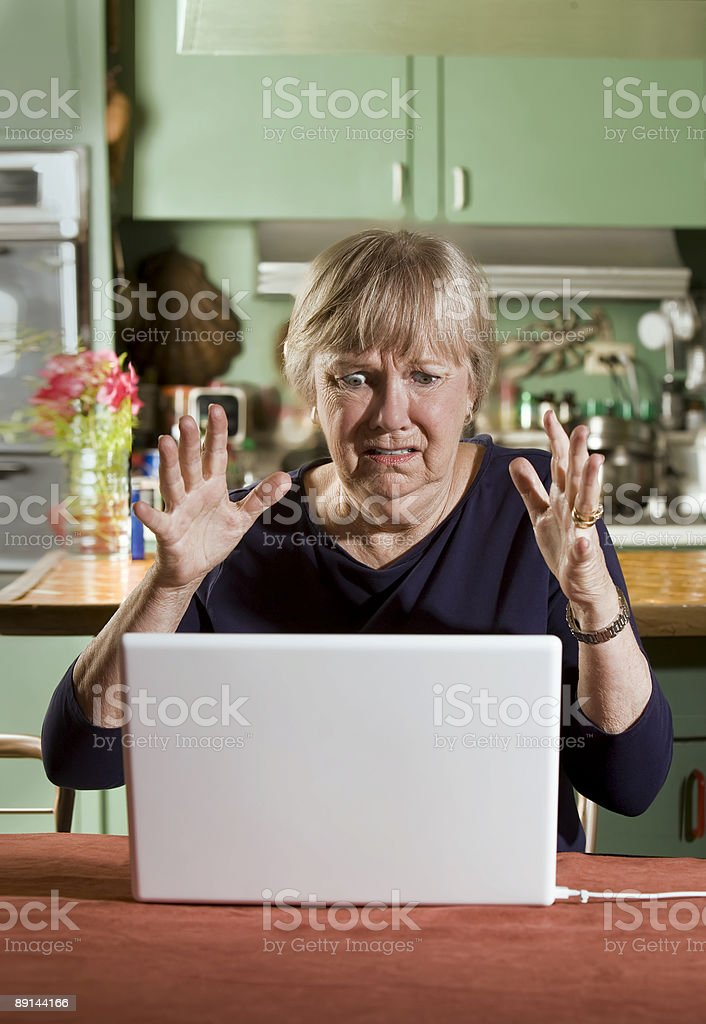 Shocked Senior Woman with a Laptop Computer stock photo