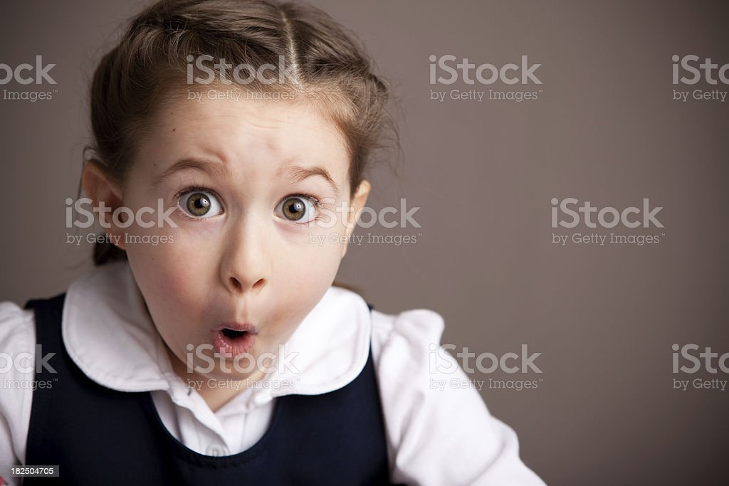 Shocked Student Girl in School Uniform stock photo