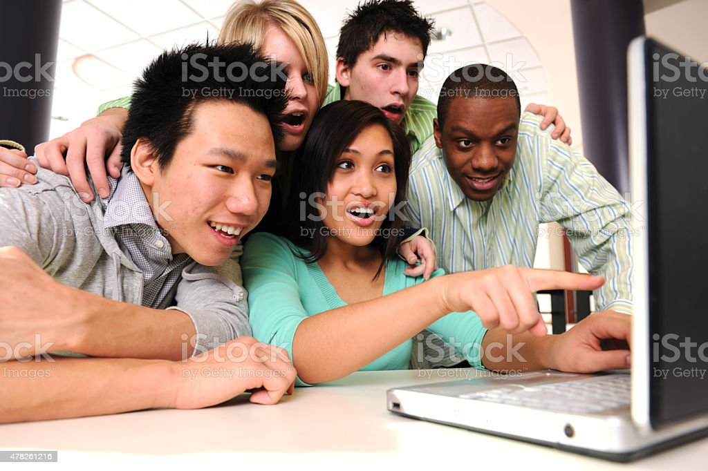 Shocked Students Looking at a Laptop stock photo
