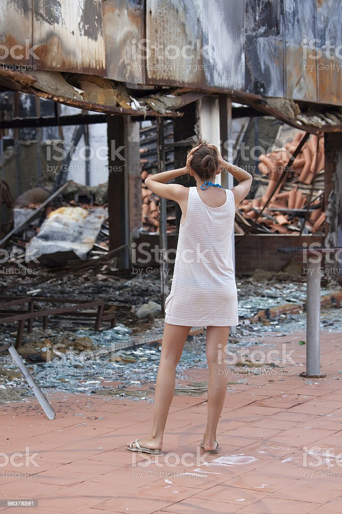 shocked woman and burned out house royalty-free stock photo