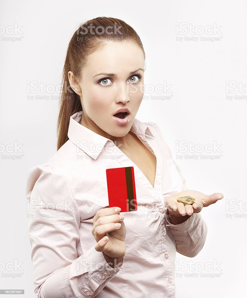 Shocked woman holding a money and credit card. royalty-free stock photo