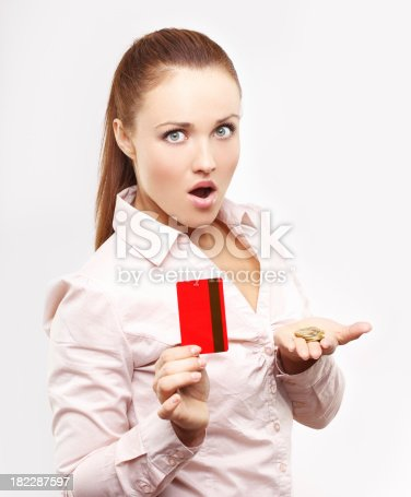 Attractive young woman holding a money and credit card.Focus is on her face.